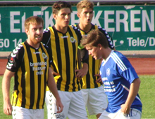 Brønshøj full-back Peter Larsen (left), captain and central defender Rasmus Minor Petersen, and striker Emil Berggren in the Wasps´ Danish FA Cup 1st round match at Fremad Amager on 22 August 2012. Brønshøj won by four goals to one. Photo: Thomas Brygger.